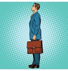 Businessman standing sideways vector image