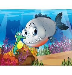 A piranha and a seahorse under the sea vector