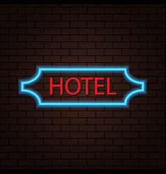 neon sign of a hotel on a brick wall vector image