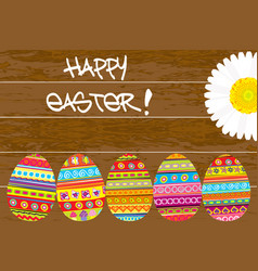 painted easter eggs on wooden background vector image