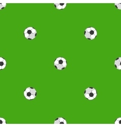Soccer balls over green field seamless pattern vector