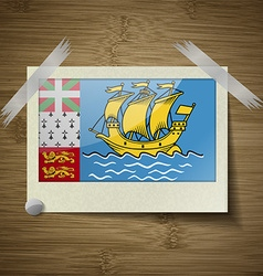 Flags Saint Pierre Miquelon at frame on wooden vector