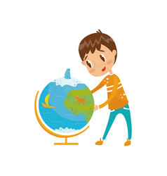 boy learning geography with big school globe vector image