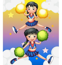 Two cheerdancers dancing with their pom poms vector image vector image