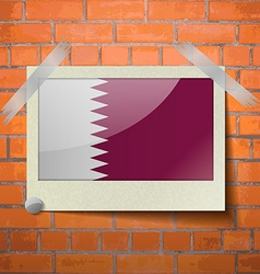 Flags Qatar scotch taped to a red brick wall vector