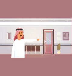 Arab business man point finger on doors vector