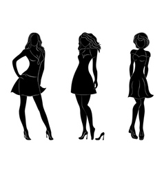 Three beautiful slim women silhouettes vector image