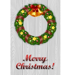 Christmas wreath on a grey wooden background vector image