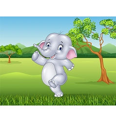 Cartoon happy elephant in the jungle vector