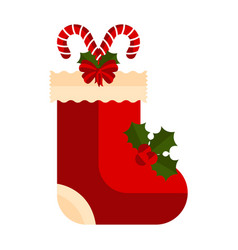 christmas sock with a cane and holly leaves icon vector image