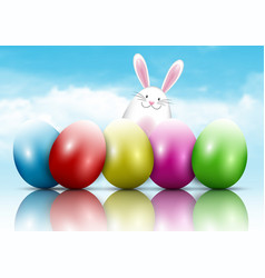 Easter bunny and eggs on a blue sky background vector