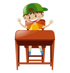 Boy sitting at the desk vector