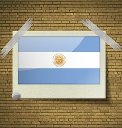 Flags of Argentina at frame on a brick background vector image