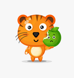 Cute tiger character carrying green apple vector