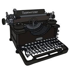 Vintage black typewriter vector image