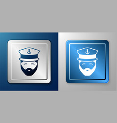 White captain of ship icon isolated on blue and vector