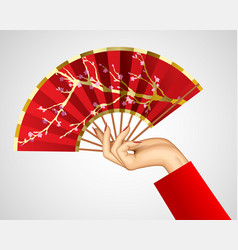 womans hand with open chinese red fan isolated on vector image