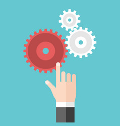 hand touching cog wheels vector image
