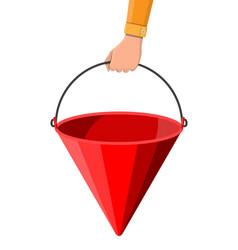 red metal fire bucket in hand fire equipment vector image