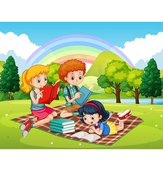 Children reading books in the park vector