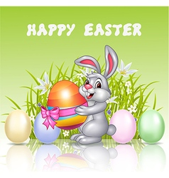 Happy cartoon bunny holding an Easter egg vector image