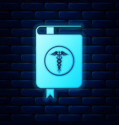 glowing neon medical book and caduceus medical vector image