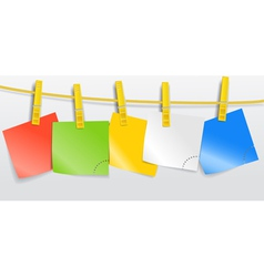 Blank color paper sheets on rope vector image