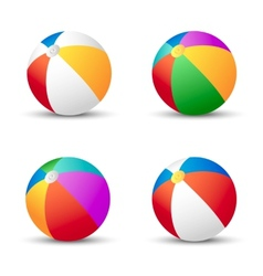 Colorful beach balls isolated on white with shadow vector image