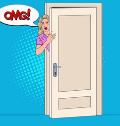 pop art shocked woman peeking from behind a door vector image