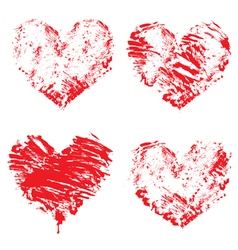 Set of grunge red color figures - hearts vector image