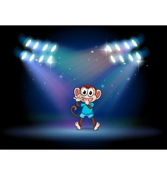 A monkey dancing at the stage with spotlights vector