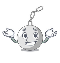 Grinning wrecking ball hanging from chain cartoon vector