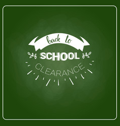 Back to school chalked label on green board vector