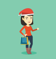 woman in santa hat shopping for christmas gifts vector image