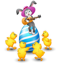 cartoon rabbit playing guitar on a large egg is de vector image