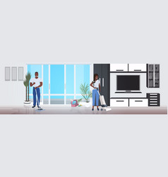 couple man woman using mop and vacuum cleaner vector image