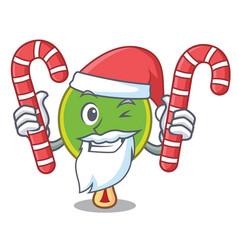 Santa with candy ping pong racket mascot cartoon vector