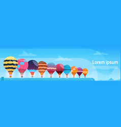 Colorful air balloons flying in day sky banner vector