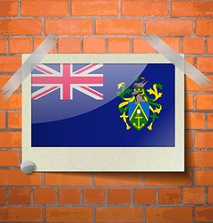 Flags Pitcairn Islands scotch taped to a red brick vector