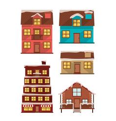 Bundle houses facades with snow vector
