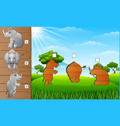 cartoon funny rhino collection set find the corre vector image