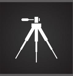 Camera tripod icon on black background for graphic vector