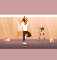 Woman blogger doing yoga exercises sportswoman vector