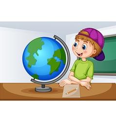 Boy looking at globe in classroom vector image vector image