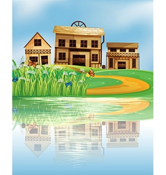 A pond with a reflection of the wooden houses vector image