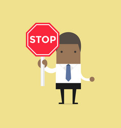 African businessman showing stop road sign vector