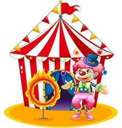 A female clown juggling in front of the tent vector image vector image