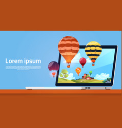 modern laptop computer with colorful air balloons vector image vector image