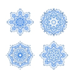 set of four round snowflakes mandalas vector image vector image