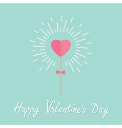 Heart on the stick with bow shining light effect vector image